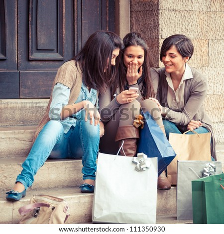 Group of Women Sending Message with Mobile Phone - stock photo