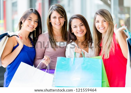 Group of women shopping at the mall looking happy - stock photo