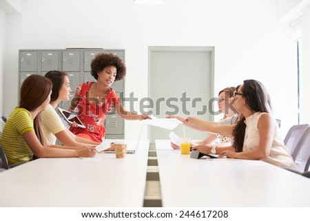 Group Of Women Working Together In Design Studio - stock photo