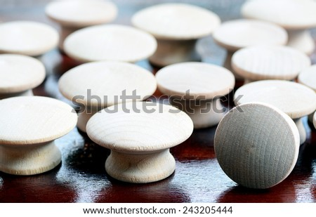 Group of wood knobs on top of a woorking table with natural light - stock photo