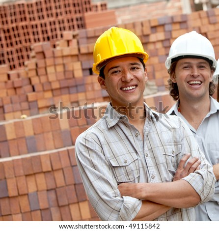 Group of workers at a construction site - stock photo