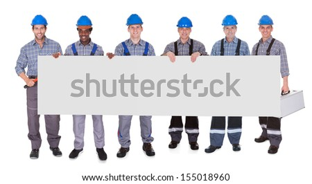 Group Of Workers Holding Placard Together Over White Background - stock photo