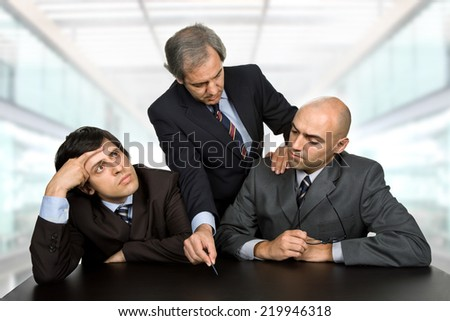 group of workers on a desk, at the office - stock photo
