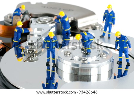 Group of workers repairing HDD. Hard Drive repair concept - stock photo