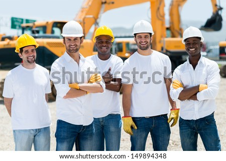 Group of working men at a construction site - stock photo