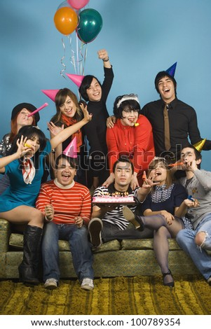 Group of young adults having birthday party - stock photo