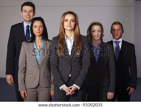 Group of 5 young and confident businesspeople, all in business suits - stock photo