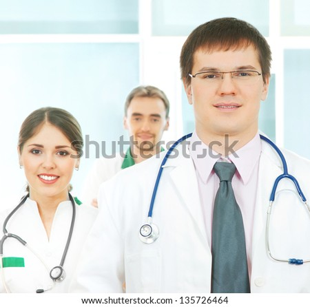 Group of young and successful doctors over the abstract background