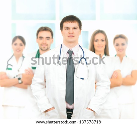 Group of young and successful doctors over the abstract background - stock photo