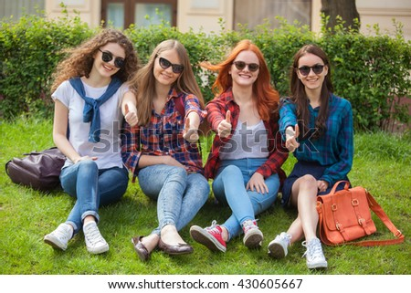 Group of young attractive smiling students dressed casual having fun on campus at the university.
