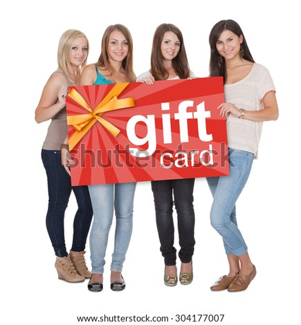 Group Of Young Beautiful Women Holding Gift Card Over White Background