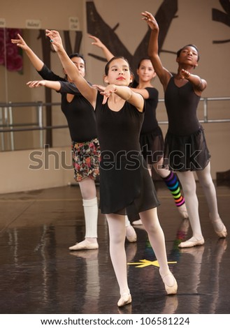 Group of young Black and Latina dance students in class - stock photo