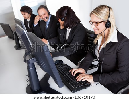 Group of young business customer service people - stock photo