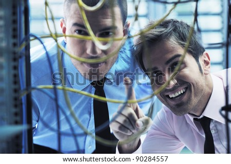 group of young business people it engineer in network server room solving problems and give help and support - stock photo