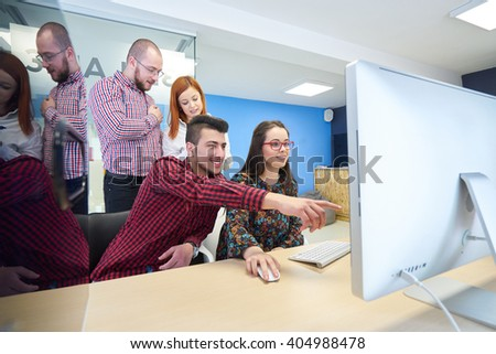 group of young business people , Startup entrepreneurs working on their venture in coworking space - stock photo