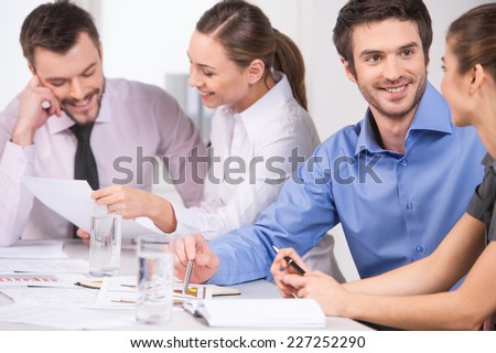Group of young business people talking in couples. business man and woman working on meeting in office  - stock photo