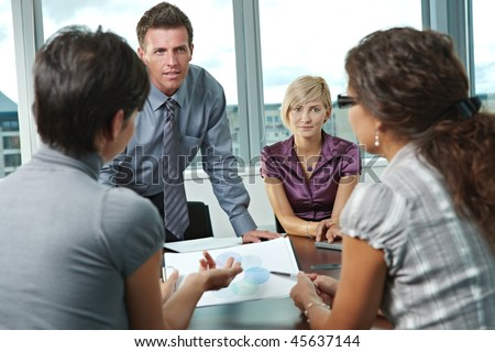 Group of young business people talking on business meeting at office. - stock photo