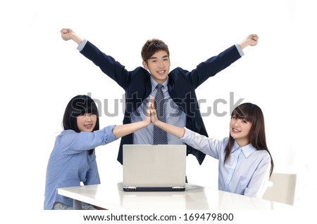Group of young business working together on a laptop with having fun - stock photo