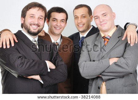 Group of young businessmen together on light background