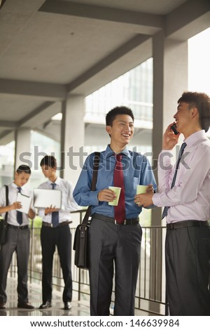 Group of young businessmen working and discussing outdoor