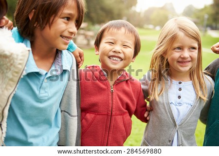 Group Of Young Children Hanging Out In Park - stock photo