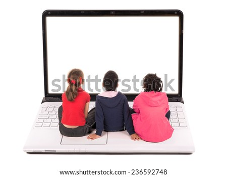 Group of young children in a laptop computer keyboard looking at the screen - stock photo