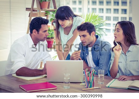Group of young colleagues having a meeting at office - stock photo