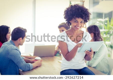 Group of young colleagues using laptop and tablet at office - stock photo