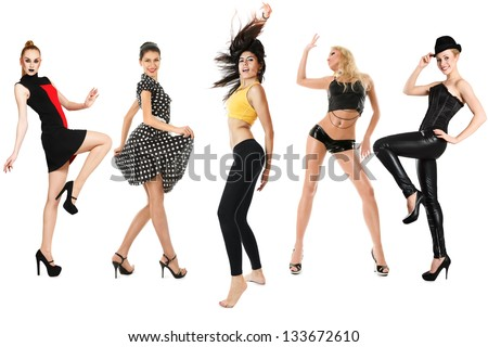Group of young dancing women isolated over white background - stock photo