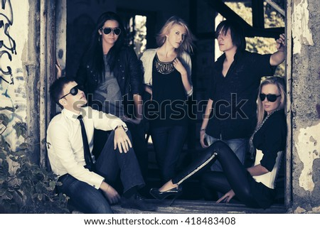 Group of young fashion men and women. Male and female stylish model outdoor - stock photo