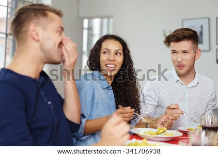 Group of Young Friends Enjoying the Conversations While Having a Dinner Together. - stock photo