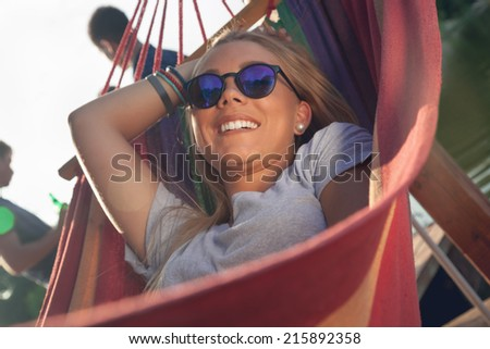 Group Of Young Friends Relaxing On A Boat Enjoying Sunny Day - stock photo