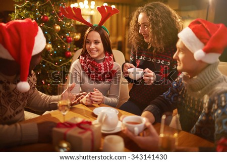 Group of young friends spending Christmas evening together - stock photo