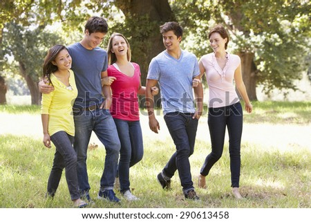 Group Of Young Friends Walking Through Countryside