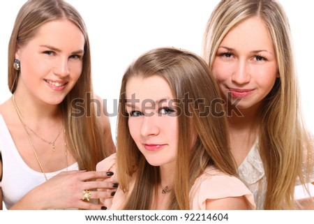 Group of young girlfriends isolated over white - stock photo