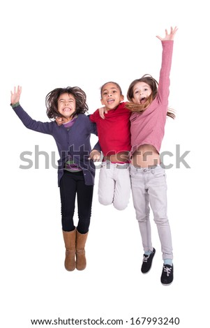 Group of young girls jumping isolated in white