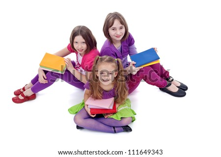 Group of young girls preparing to go back to school - on white background