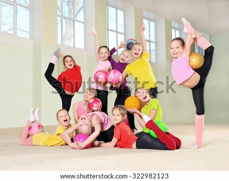 Group of young gymnasts in gym