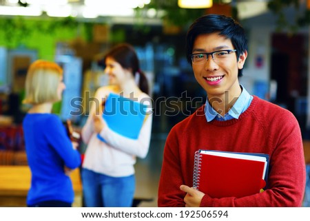 Group of young happy students at university campus - stock photo