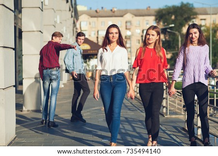 Group of young man flirting with women in city. Friendship, leisure, student's lifestyle, first love, communication concept