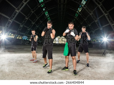 group of young men on kick box training - stock photo