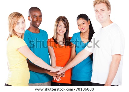 group of young multicultural friends hands together