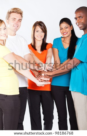 group of young multiracial people hands together - stock photo