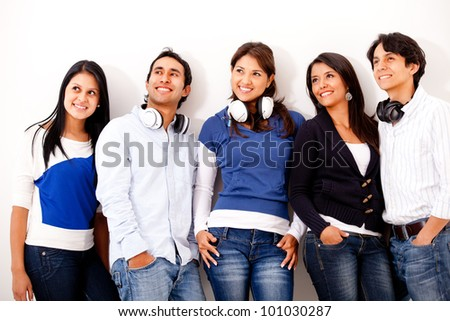 Group of young music lovers with headphones and smiling