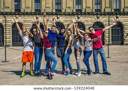Group of young people are walking around the Stockholm, Sweden