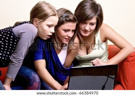 Group of young people around laptop - stock photo