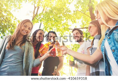 Group of young people cheering, having fun outdoors - stock photo