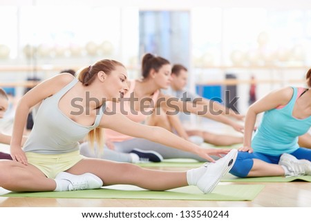 Group of young people engaged in the gym - stock photo