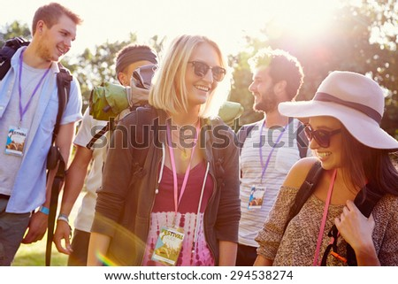 Group Of Young People Going Camping At Music Festival - stock photo