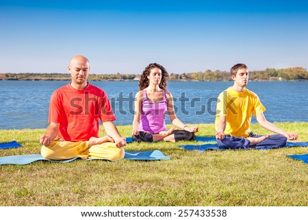 Group of young people have meditation on yoga class. Yoga concept. - stock photo